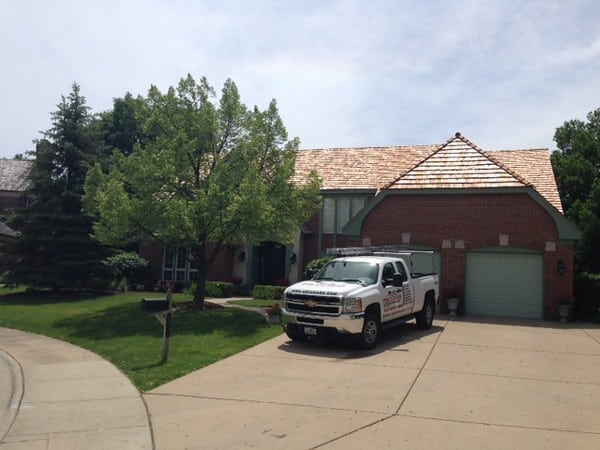 A cedar roof contractor can apply preventative treatment for moss growth