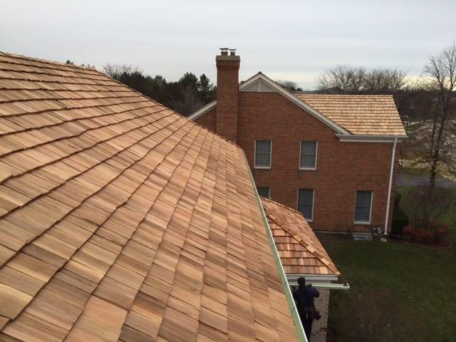 Moss growth can ruin a beautiful cedar roof