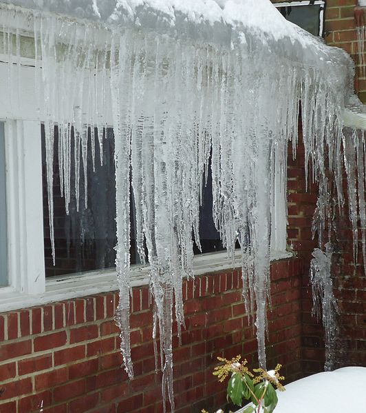 Ice dams will damage your cedar roof if they are not dealt with properly by a professional